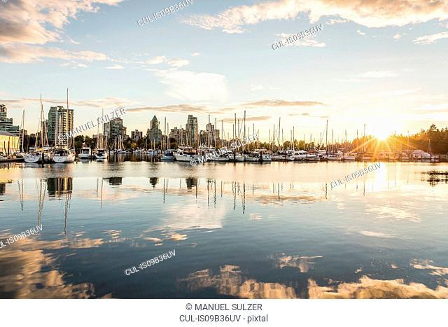 Marina and city skyline at dusk, Vancouver, Canada