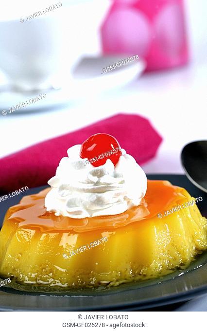 Tocino de cielo egg yolk and sugar sweet with whipped cream and morello