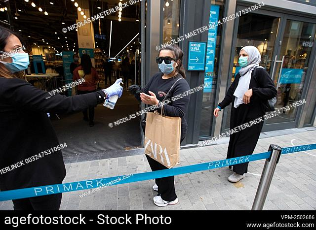 Illustration picture shows shopping people waiting outside a Primark shop in the Nieuwstraat/ Rue Neuve shopping street in Brussels, Saturday 16 May 2020