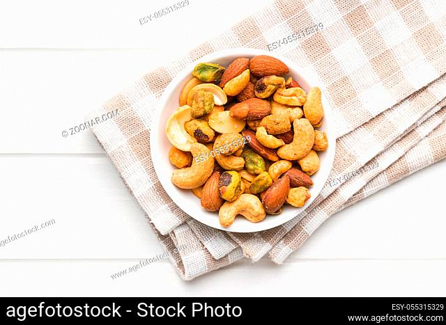 Spicy flavoured nuts. Mix of nuts in bowl. Top view