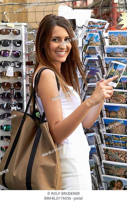 Caucasian woman browsing postcards