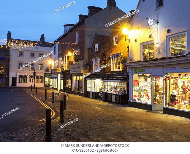 Christmas lights and the Oldest Chemist Shop in England in the Marketn Place at Knaresborough North Yorkshire England