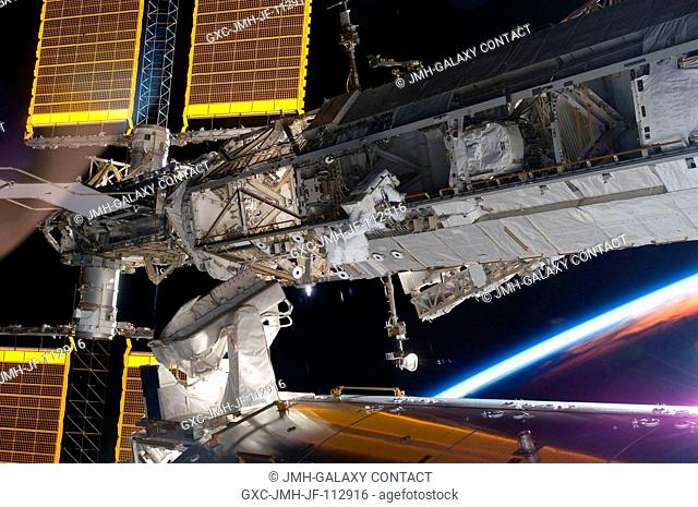Astronaut Steve Bowen, STS-126 mission specialist, participates in the mission's first session of extravehicular activity (EVA) as construction and maintenance...