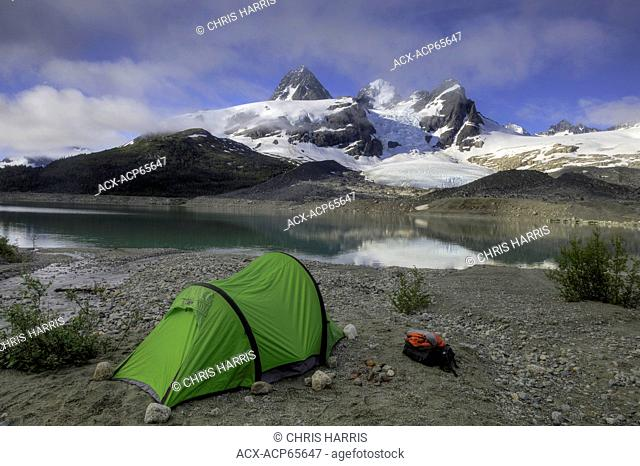 Tent near stream and glacier, Chilcotin, Coast Mountains, British Columbia, Canada
