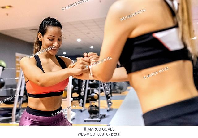 Two women working out in gym