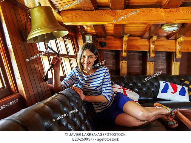 Young woman in a sailboat, galleon. Basque Country. Spain