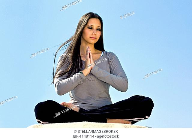 Young woman, 20, doing yoga exercises