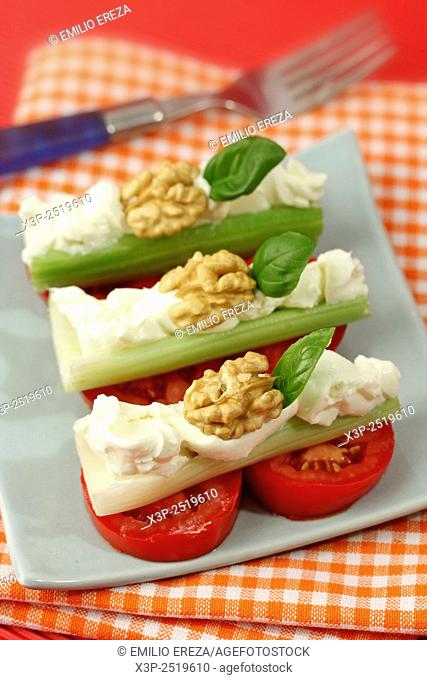 Celery sticks with cheese and walnuts