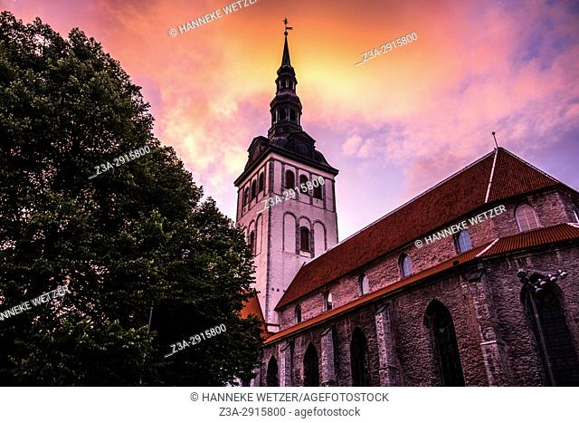 Sunset over St. Olaf's church in Tallinn, Estonia