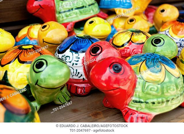 Painted mud turtles in crafts store in Benacazon. Seville. Andalusia. Spain