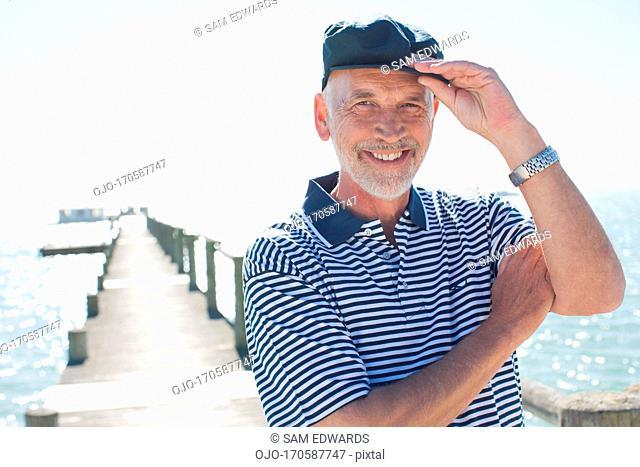 Man in cap standing on pier