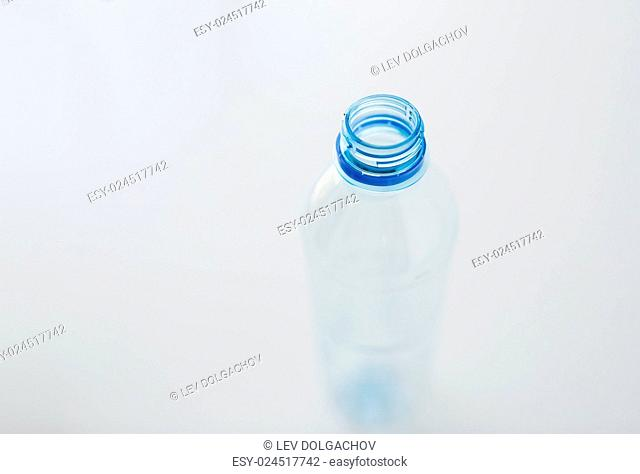 recycling, healthy eating and food storage concept - close up of clean empty used plastic water bottle on table