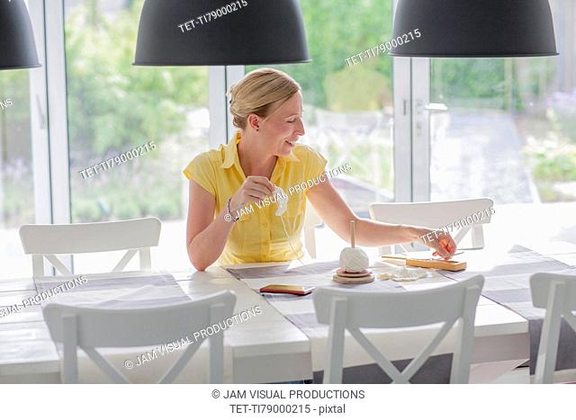 Woman embroidering at home