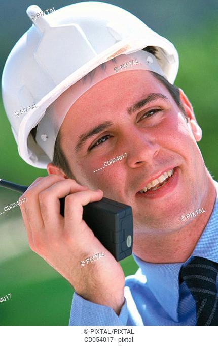 Foreman giving orders by walkie-talkie