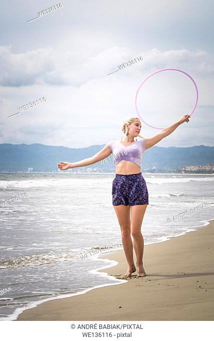 Female hoola hoop performer at the beach. Riviera Nayarit, Pacific Coast, Mexico