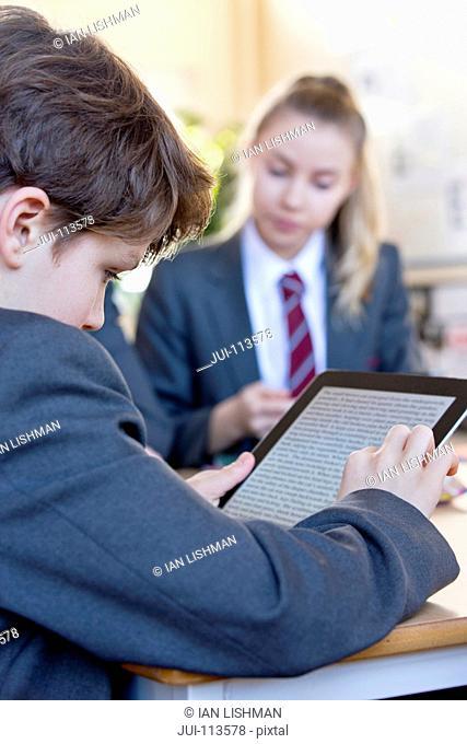 High school student using digital tablet in classroom