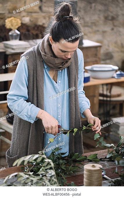 Woman arranging twigs