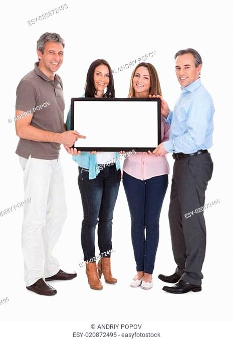 Group Of People Holding Billboard