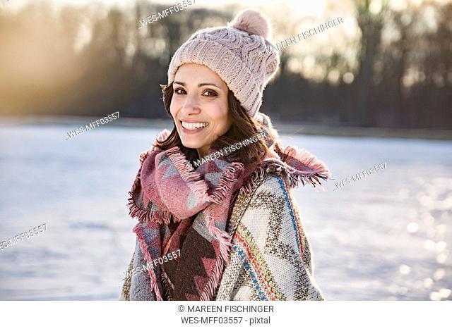 Portrait of happy woman outdoors in winter