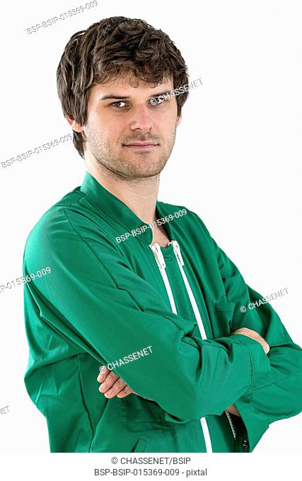 worker wearing green working coat crossed arms in white background
