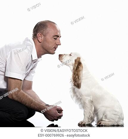 red English Cocker Spaniel and his master on studio white background