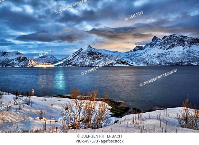 winter landscape in fjord of Husøy i Senja,night shot with moon light, Senja, Troms, Norway, Europe - Husoy i Senja, Troms, Norway, 18/02/2016