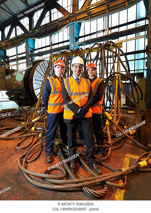 Steel Engineer & Workers With Ropes