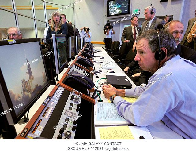NASA Administrator Michael Griffin watches the launch of the Space Shuttle Discovery (STS-124) from the Launch Control Center on May 31, 2008
