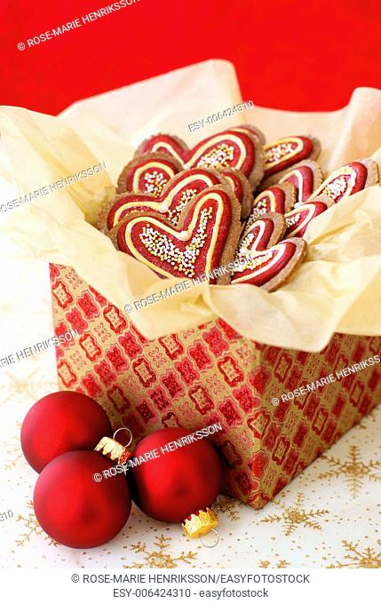 Christmas decorated gingerbread cookies in a giftbox