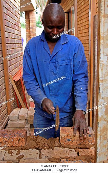 Brick layer laying bricks, Moreleta Park, Pretoria, Gauteng Province, South Africa