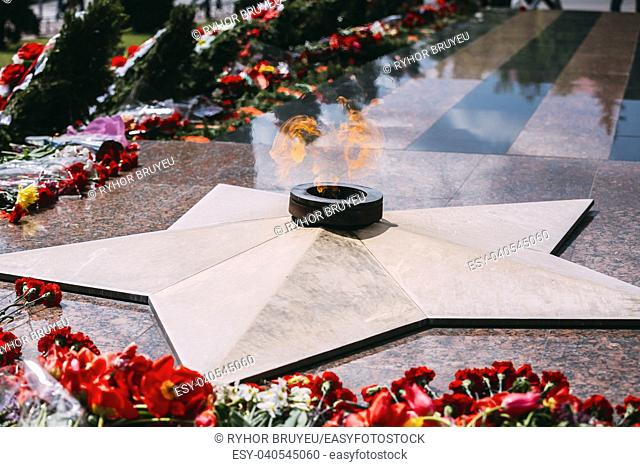 Wreaths and flowers lie on a communal grave of Soviet soldiers who died during the liberation of Gomel and Belarus from German invaders in World War II