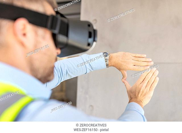 Architect with VR glasses at construction site