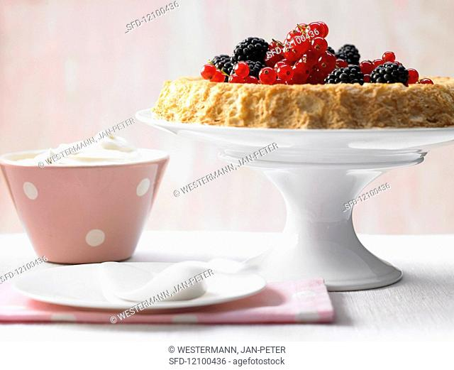 Light berry tart with whipped cream cheese and maple syrup