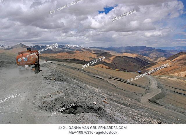 Trucks descending from Taglang La (5, 359m pass on Manali Leh road). . Ladakh India