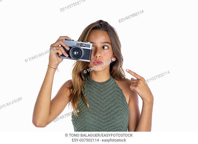 Brunette teen girl vintage photo camera portrait on white background