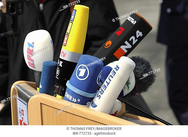 German press microphones attached to a lectern