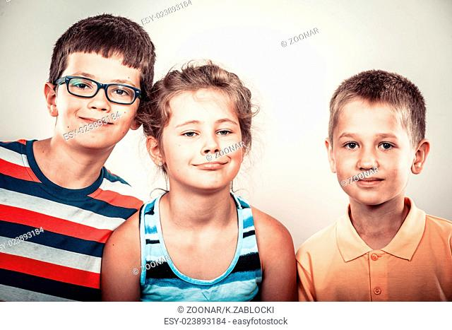Kids little girl and boys making silly face expression