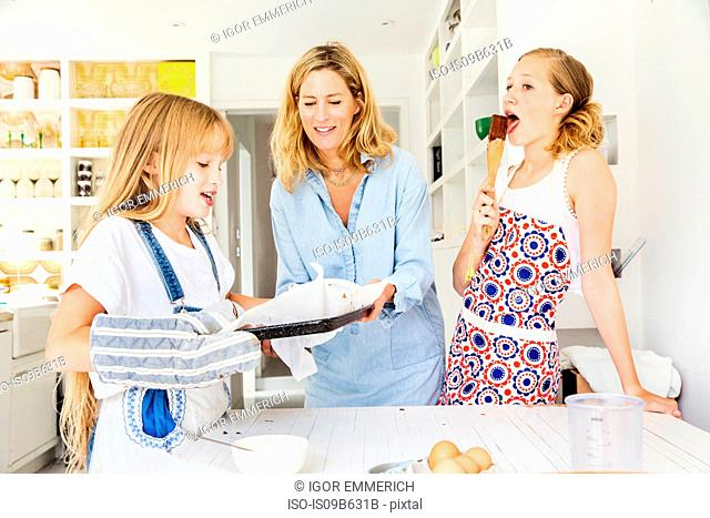 Mother and daughters baking in kitchen