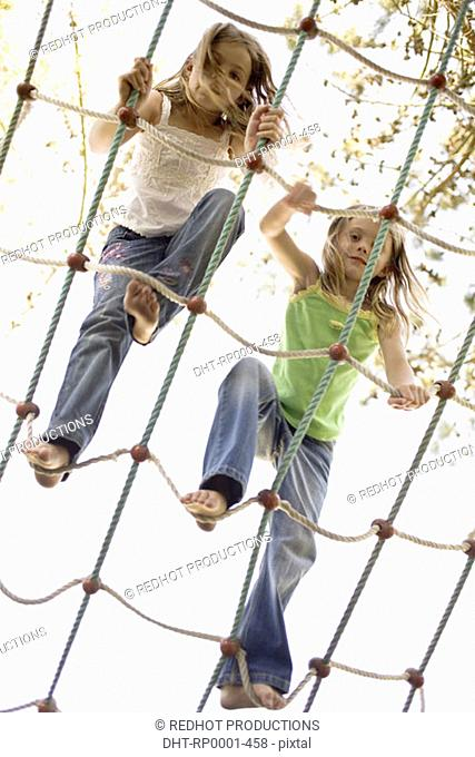 Children on rope climbing frame