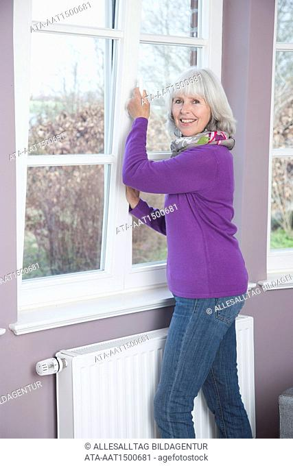 Woman ventilating the room