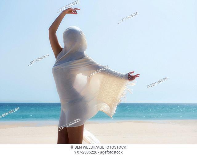 Young woman at the beach. Tarifa, Costa de la Luz, Cadiz, Andalusia, Spain