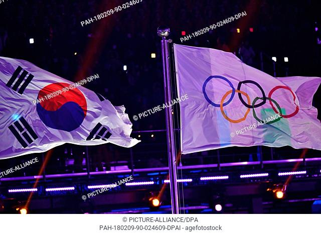 The South Korean and Olympic flags fly at the opening ceremony of the Winter Olympics in Pyeongchang, South Korea, 9 February 2018