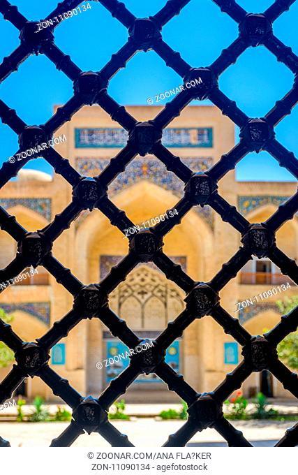 Mir-i-Arab madrassa thru the hexagonal lattice, Bukhara, Uzbekistan