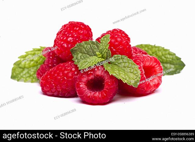 View of several tasty raspberries isolated on a white background