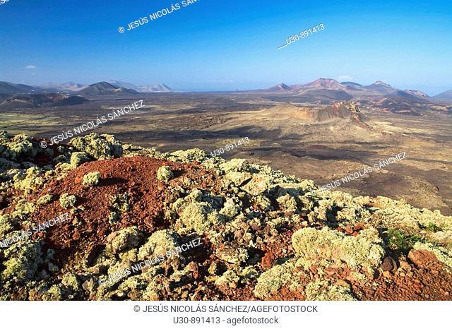 View of Santa Catalina volcano and El Cuervo volcano from Caldera Colorada volcano, in The Volcanoes Natural Park  Tinajo, Lanzarote
