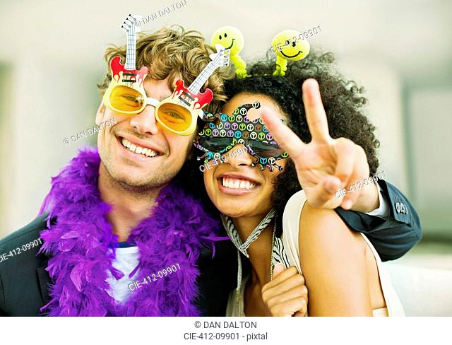 Couple wearing decorative glasses at party
