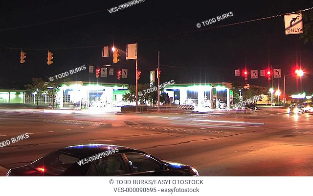 Time-lapse of night traffic at busy intersection
