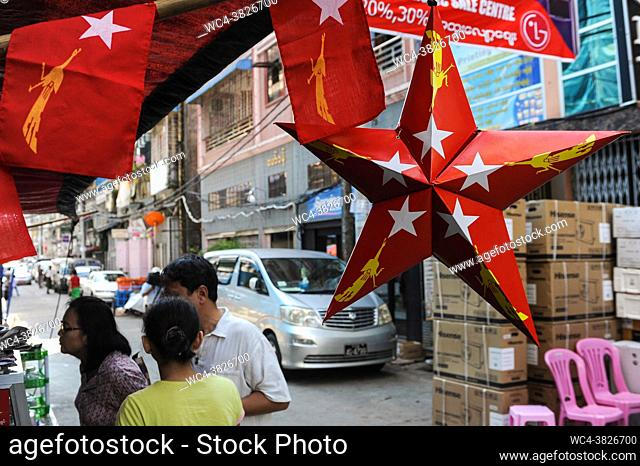 Yangon, Myanmar, Asia - A red star made of cardboard and little flags with the logo of the NLD party (National League for Democracy) are seen hanging at a...
