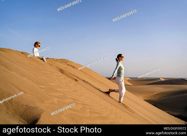 Mother and daughter in sand dunes, Gran Canaria, Spain