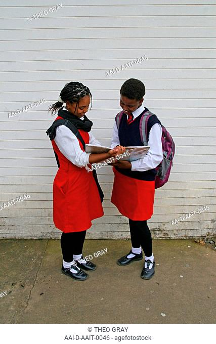 School girls reading outside classroom, St Mark's School, Mbabane, Hhohho, Kingdom of Swaziland